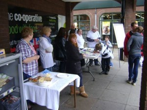 Handing out invitations and hot-cross buns outside the Co-Op